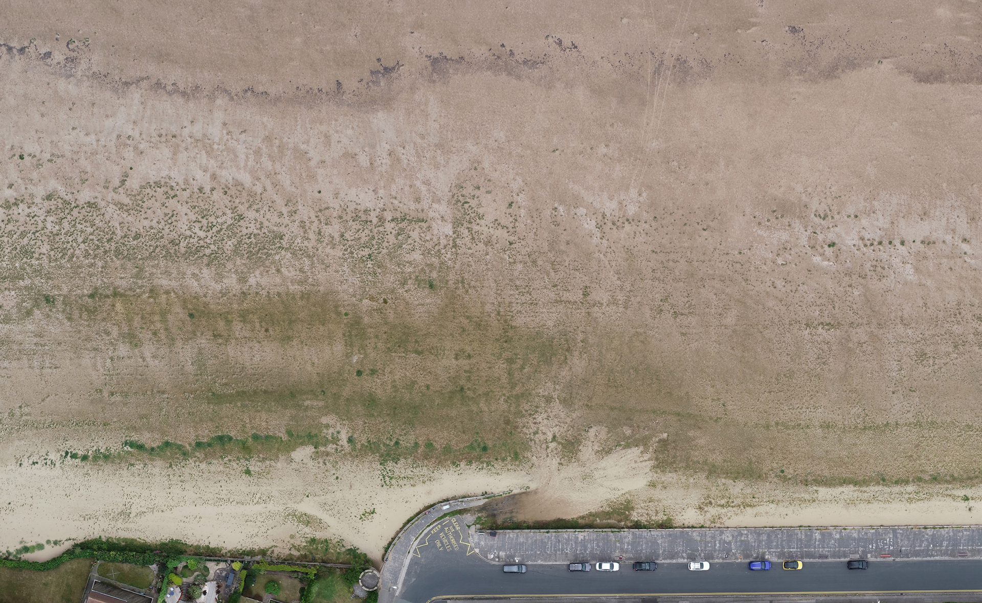 At Kings Gap slipway we can see from above the darker 'plume' where sand is wetter and feeding vegetation.