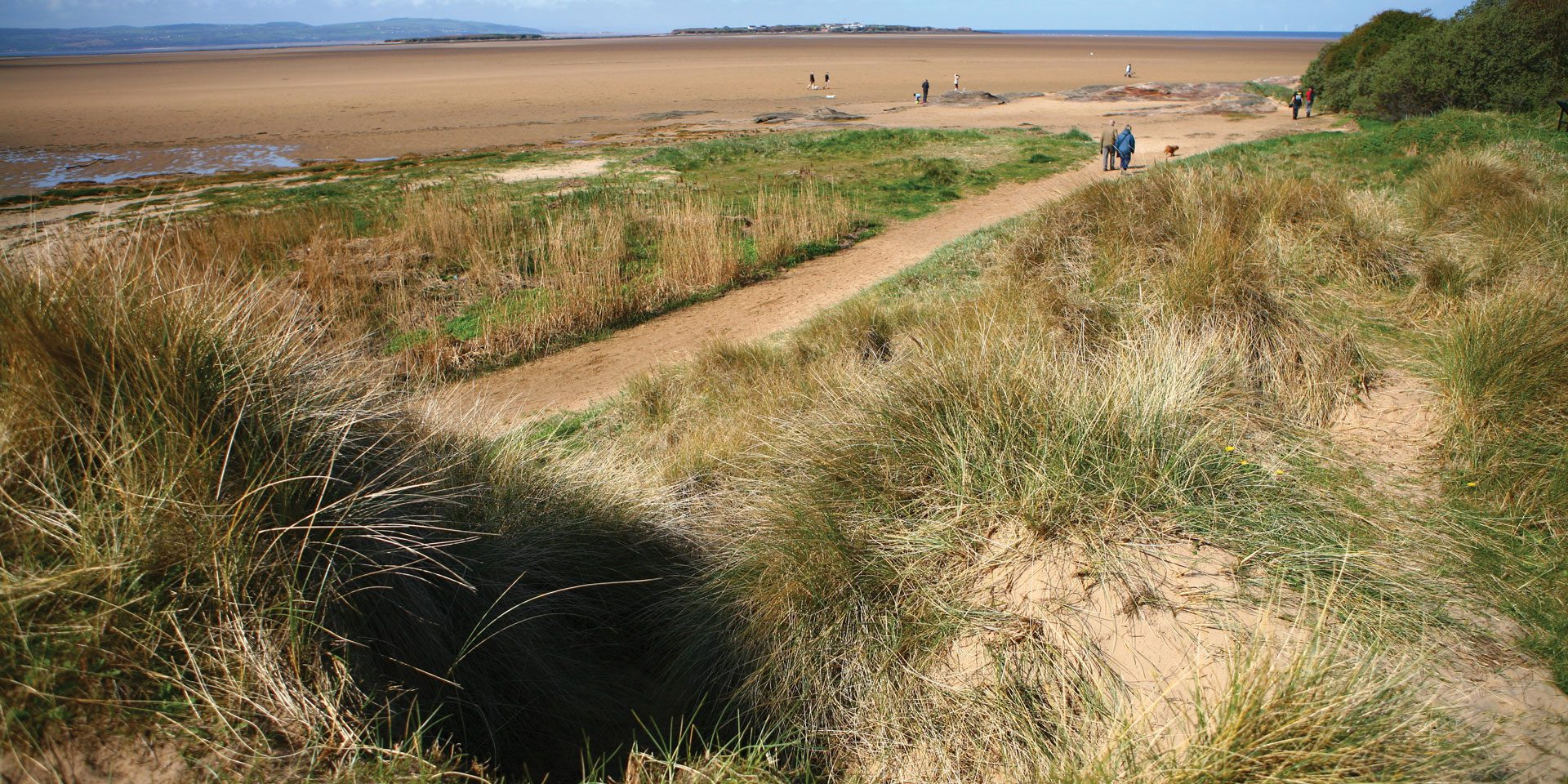 The dune system at Red Rocks looking out to Hilbre; a haven for willdlife and a draw for visitors © HVL